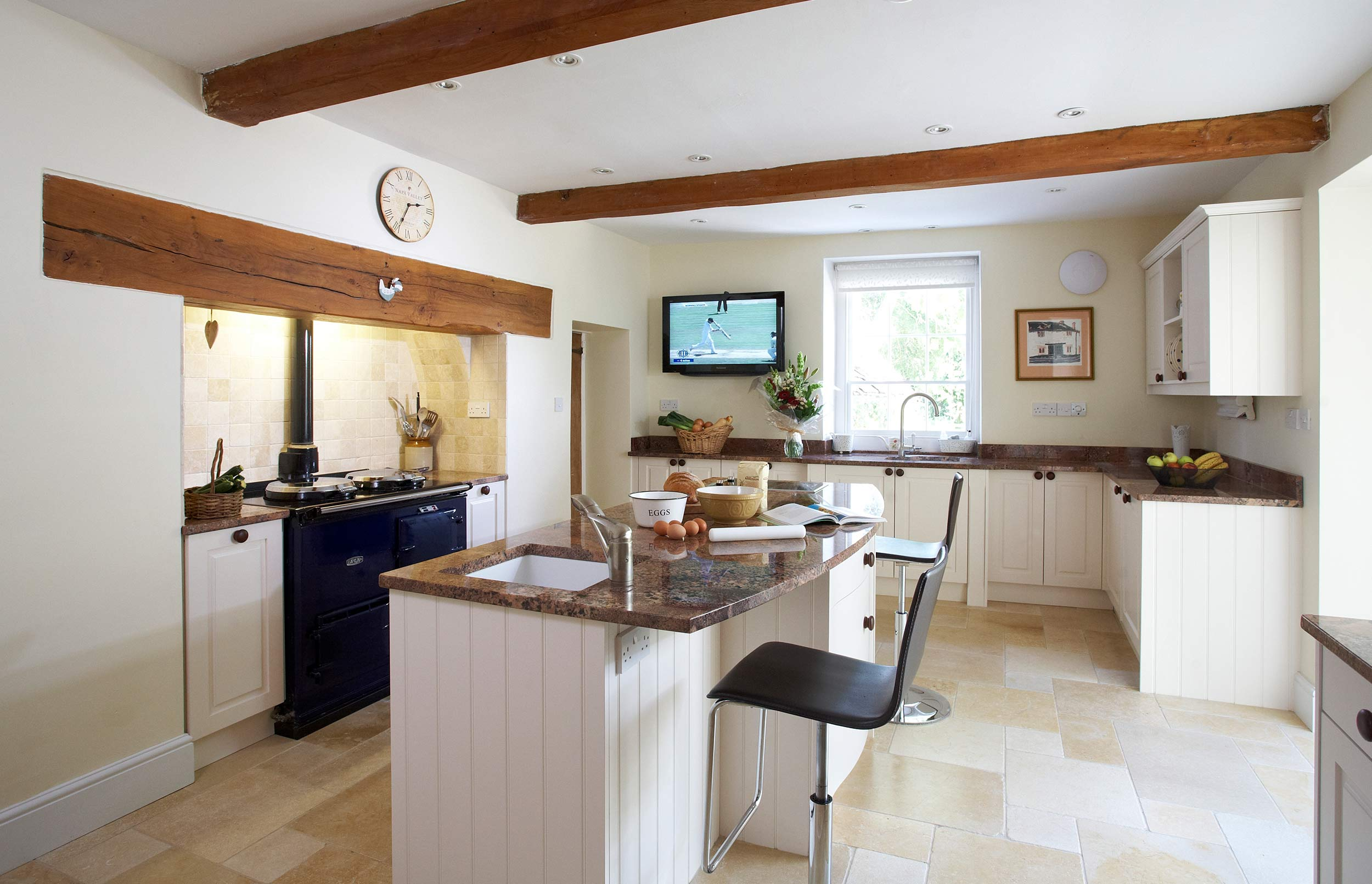Classic Bespoke Kitchen with Blue Range, Stone Floor and Cream Cupboards