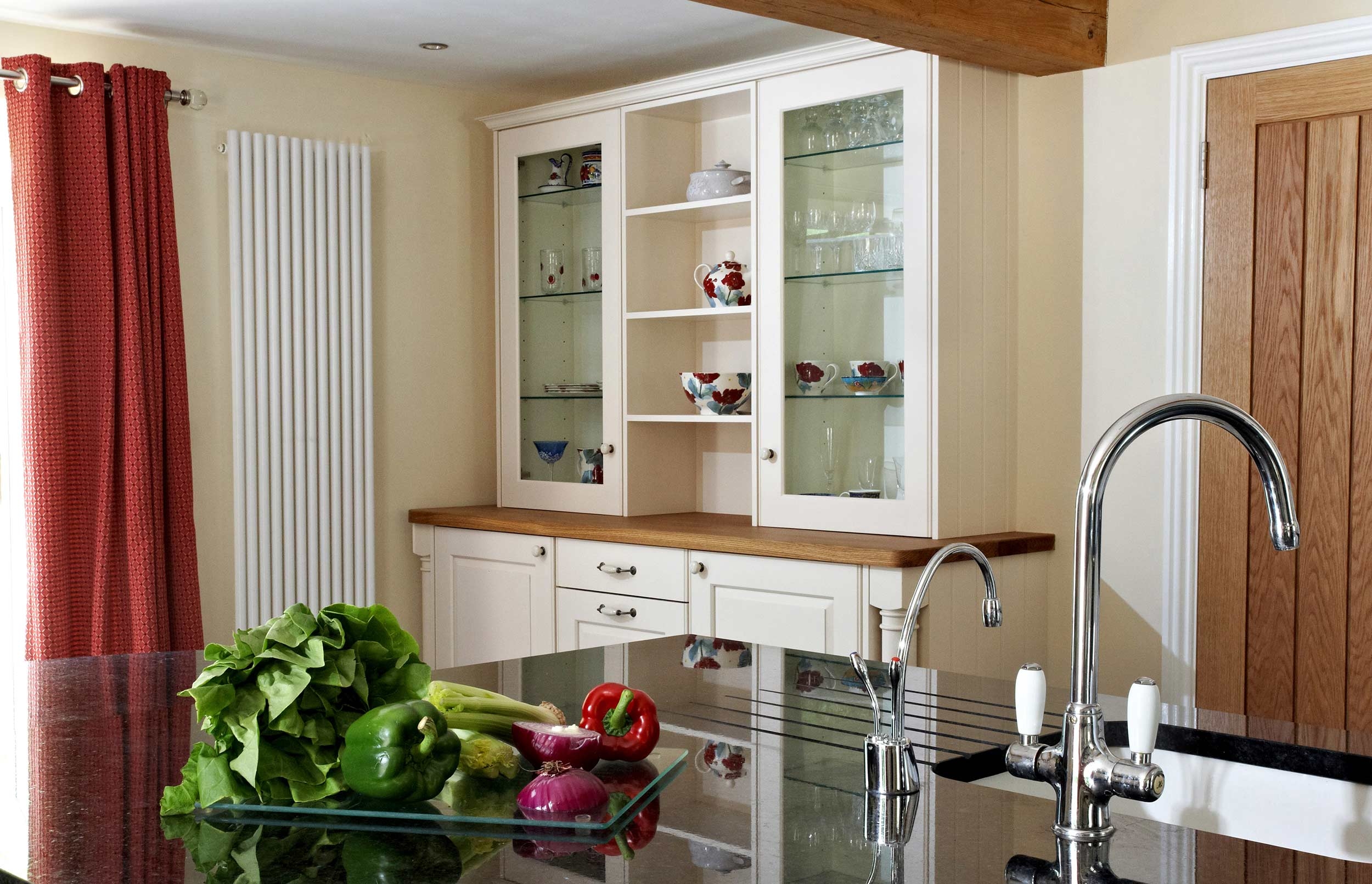 Stylish Bespoke Kitchen - View across Island to Display Cabinet