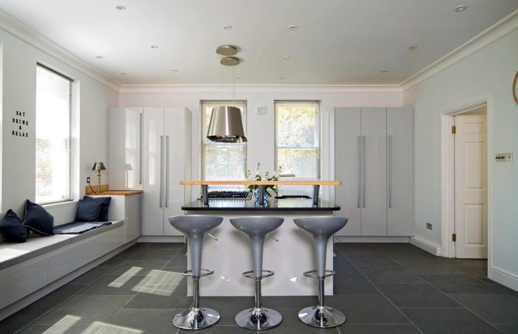 Modern Minimalist Bespoke Kitchen with Dark Stone Flooring