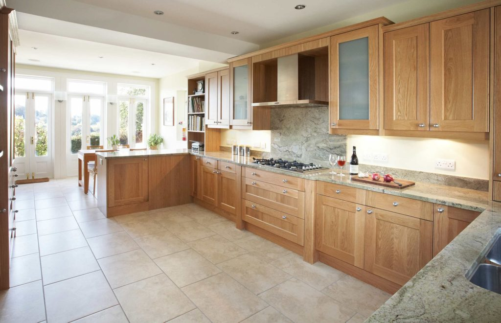Lavish Bespoke Kitchen View with Granite Surfaces and Stone Floor