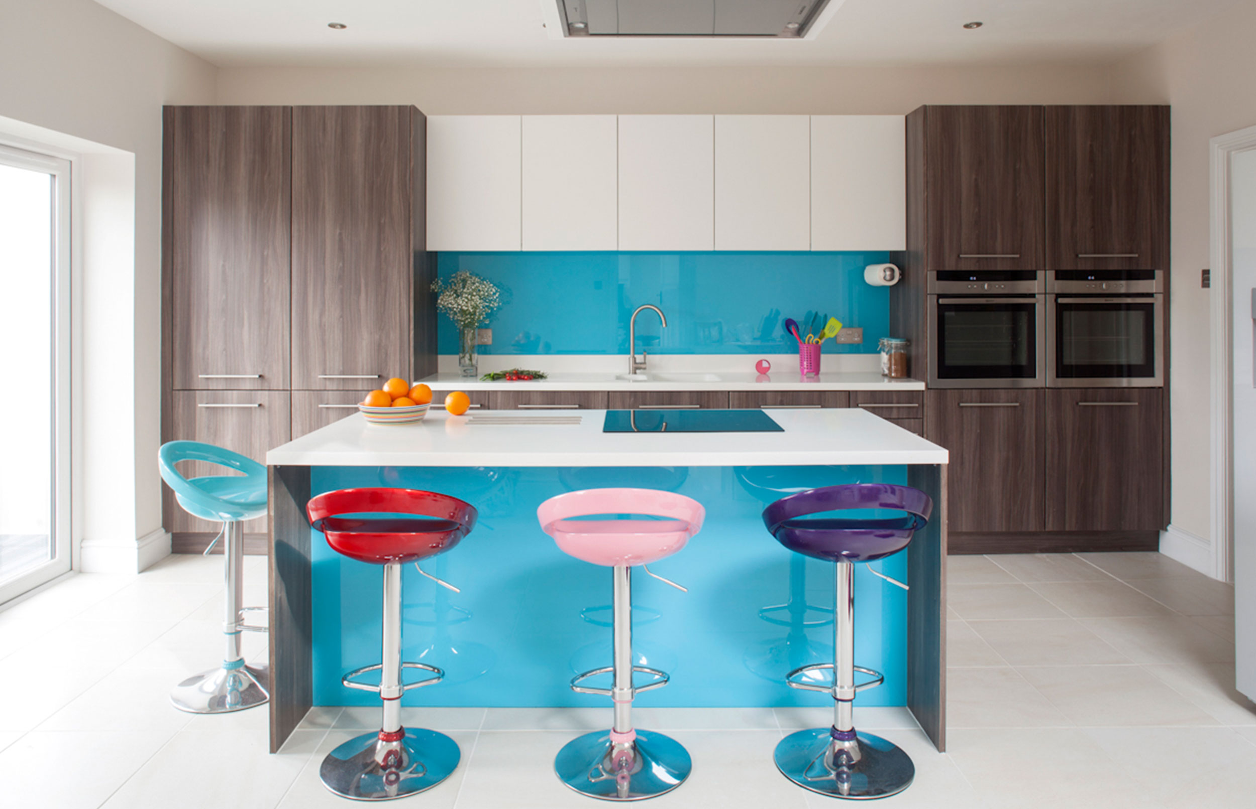 Dynamic Bespoke Kitchen with Stools, Island and Preparation Area in View