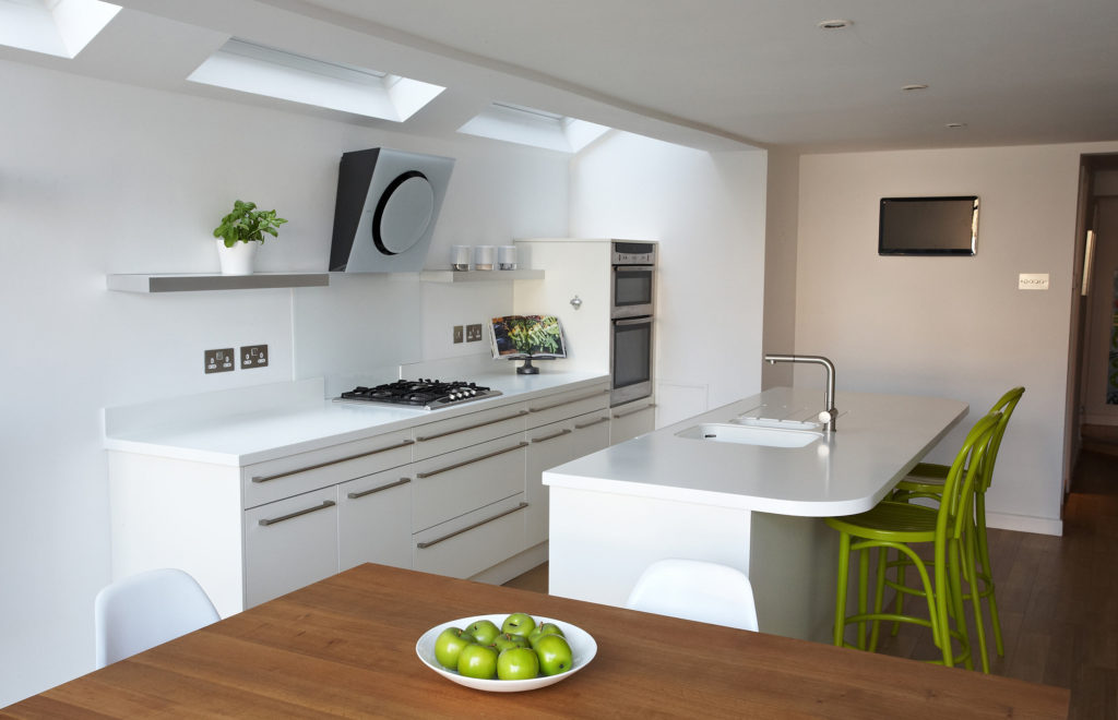 Pure Bespoke Kitchen with Green Chairs and Island in View