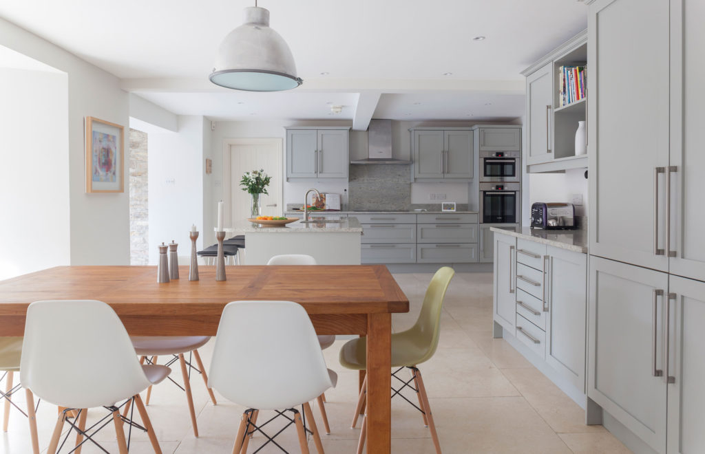 Timeless Bespoke Kitchen View across Dining Table to Island