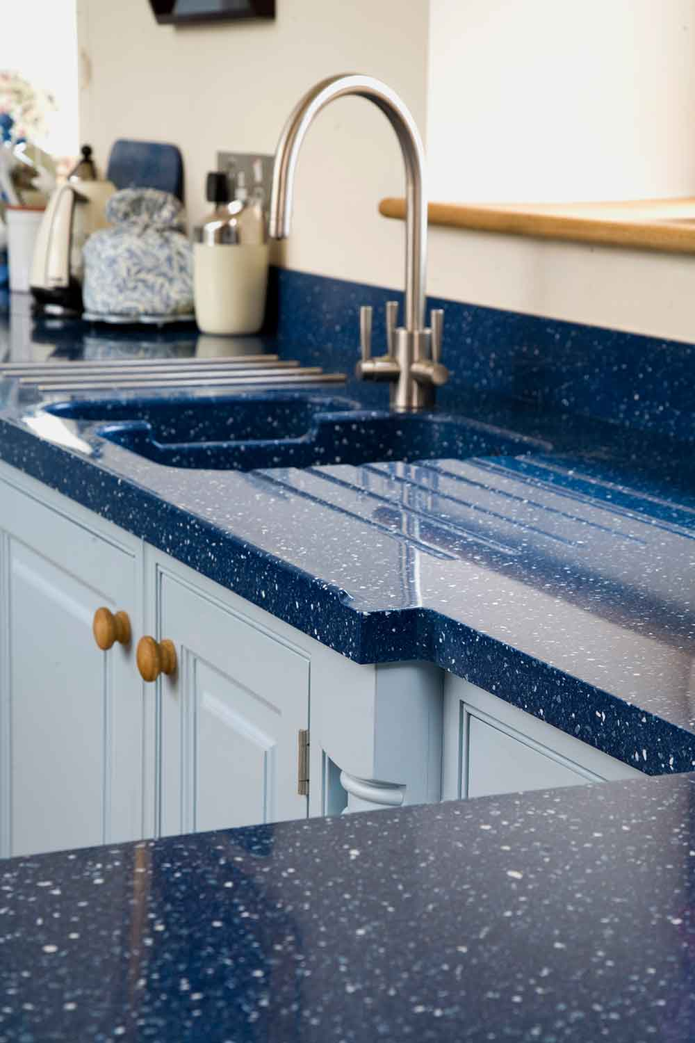 Close up of Blue Kitchen Surface Top with View of Sink and Tap