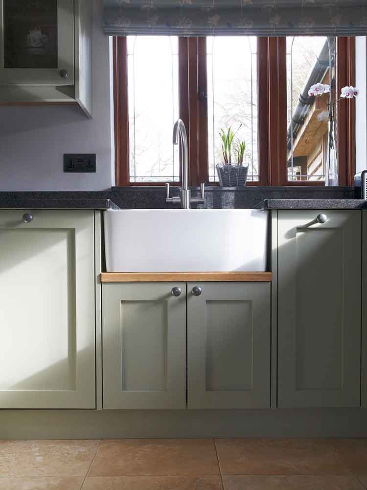 Cosy bespoke country kitchen sink detail