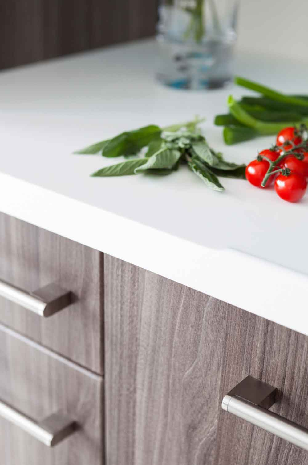 Detailed close up shot of Kitchen Surface with Tomatoes