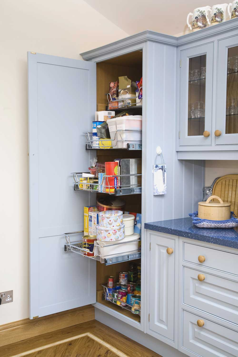 Kitchen cupboard with slide out wire drawers for easier access