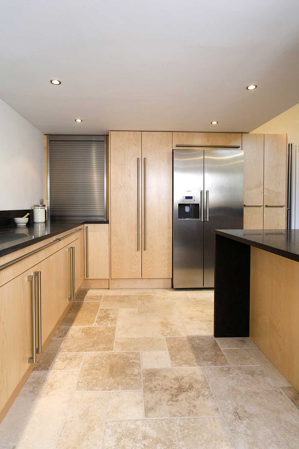 Contemporary bespoke city kitchen with beautiful stone flooring