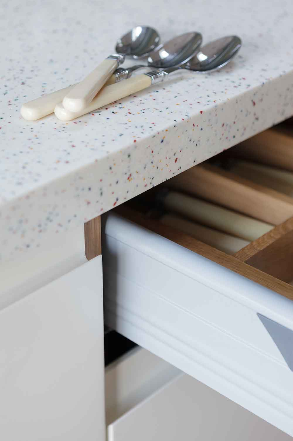 Closeup shot of kitchen drawer and surface top
