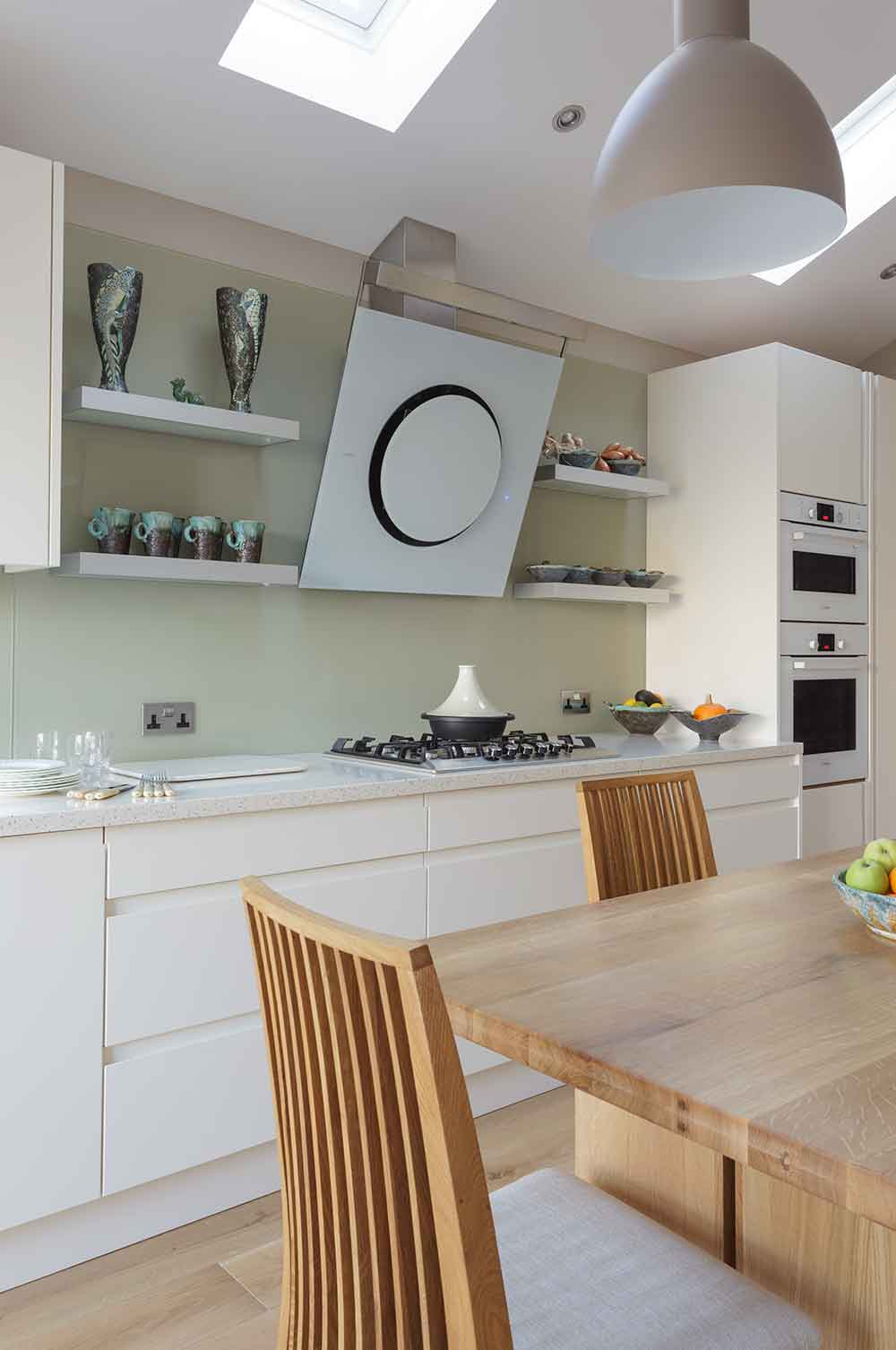 Modern compact bespoke kitchen with contemporary extractor fan