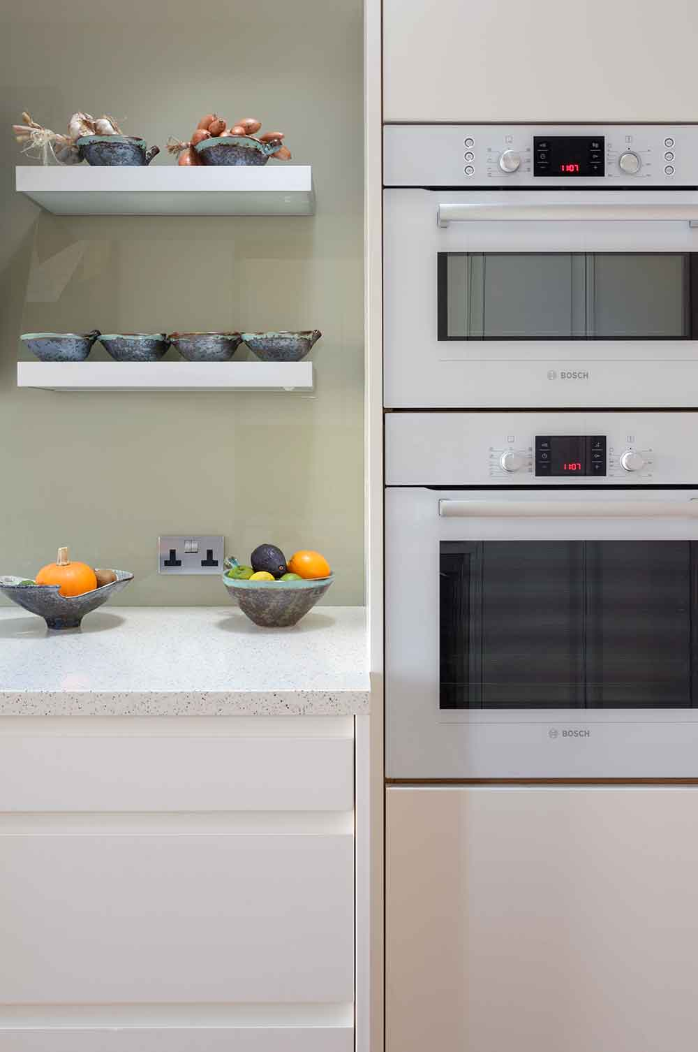 Modern compact bespoke kitchen twin oven - partial view