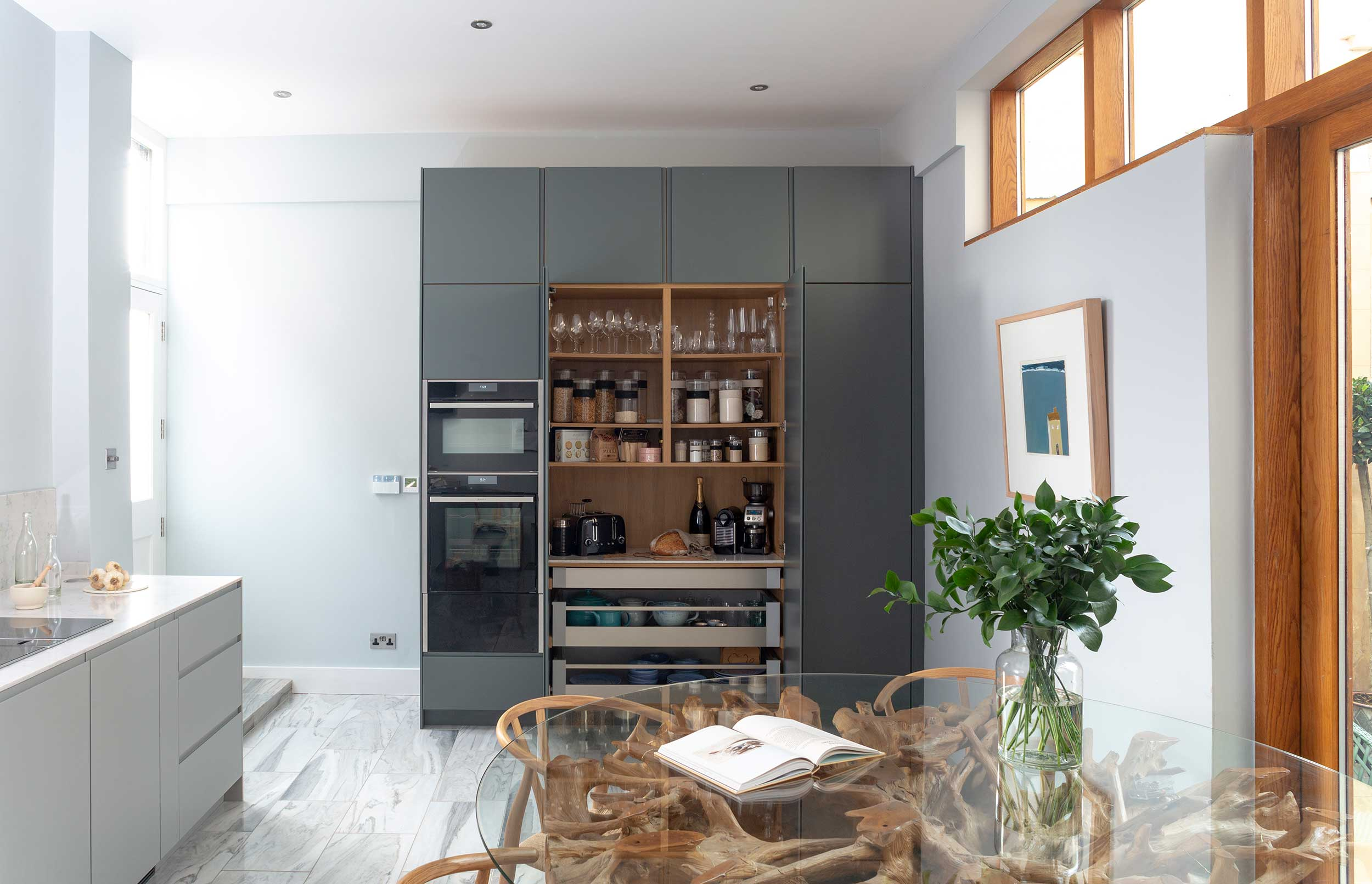 Understated Minimal kitchen cupboard open