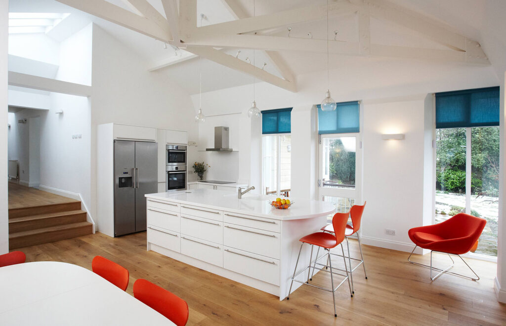 Contemporary kitchen with pop of orange and blue